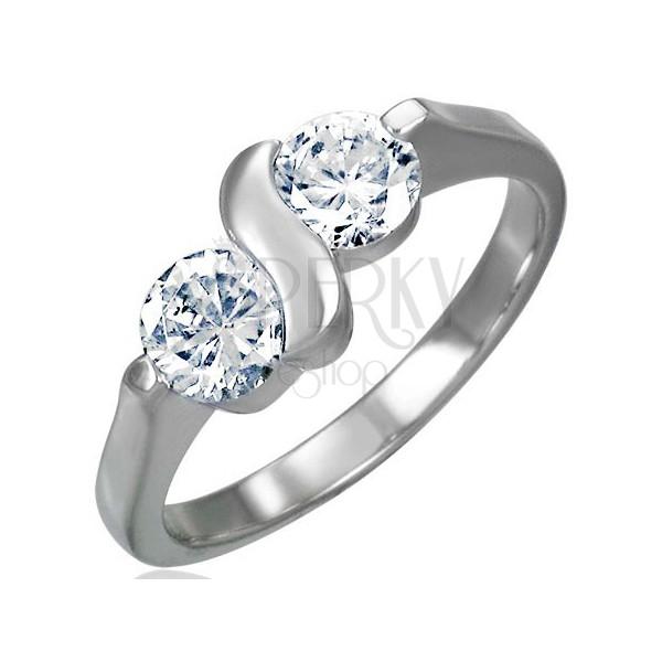Zaročni prstan z dvema okrasnima kamnoma in S-linijo
