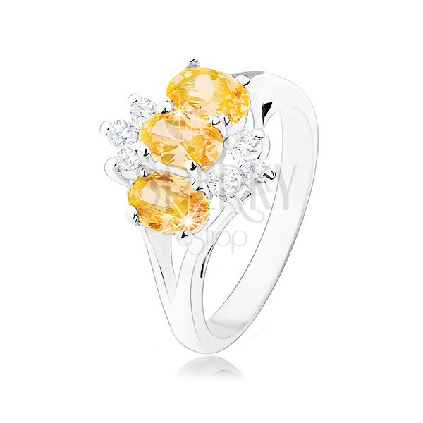 Bleščeč prstan srebrne barve, rumeni cirkonski ovali, prozorni cirkoni