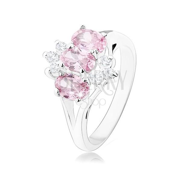 Sijoč prstan srebrne barve, rožnati ovalni cirkoni, prozorni cirkoni