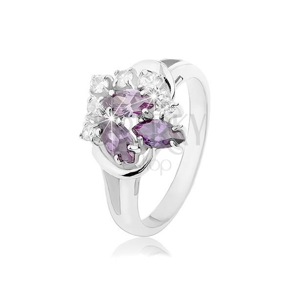 Prstan srebrne barve, razdeljena kraka, vijolična zrna, okrogli prozorni cirkoni
