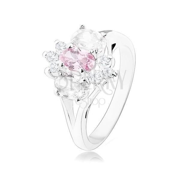Lesketav prstan srebrne barve, razdvojena kraka, rožnato-prozoren cvet