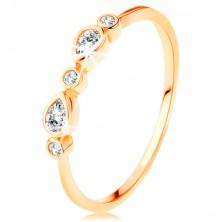 Prstan iz rumenega 14K zlata - okrogli cirkoni in cirkona v obliki solze prozorne barve, sijoča kraka