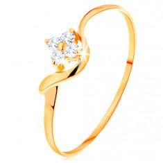 Prstan iz rumenega 14k zlata - cvet iz prozornih cirkonov, valovit krak