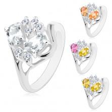 Prstan srebrne barve, razdeljena kraka, barvni ovali, prozorni cirkoni