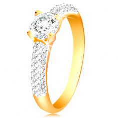 14-k zlati prstan - sijoča kraka, dvignjen okrogel prozoren cirkon