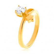 Jekleni prstan zlate barve, zvezda in okrogel prozoren cirkon
