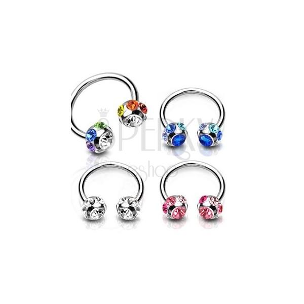 Jeklen piercing - podkev s svetlečim cirkonom znotraj kroglice, okrašene z majhnimi cirkoni